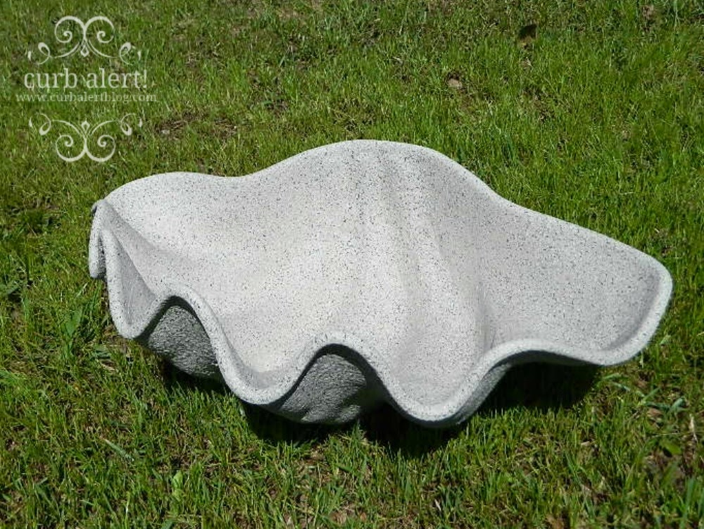 Ballard Designs Inspired Faux Giant Clam Shell Planter transformed by using Rusto-oleum stone texture spray paint on a plastic shell bowl.  A great high-end knockoff for a fraction of the price!  via Curb Alert! Blog
